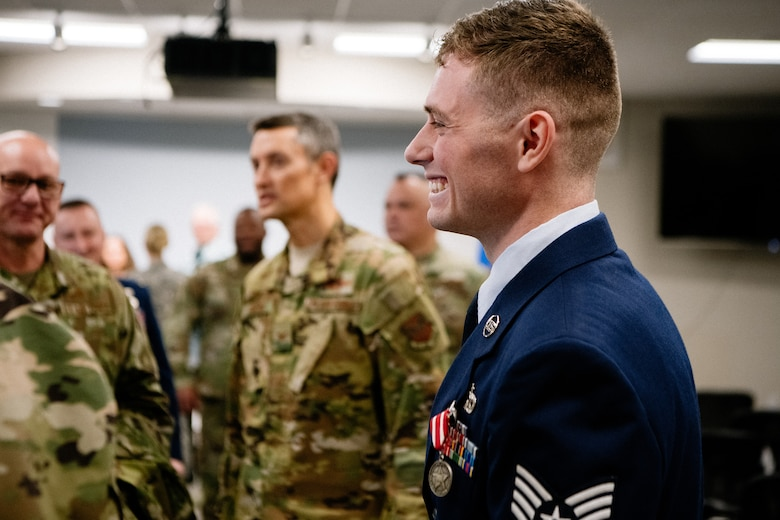 Staff Sgt. Benjamin Anderson, an air freight journeyman assigned to the 137th Special Operations Logistics Readiness Squadron, shakes hands and thanks attendees in a receiving line, during an Oklahoma Star of Valor ceremony March 7, 2020, at Will Rogers Air National Guard Base, Oklahoma City. Guests had the opportunity to hear Anderson's firsthand account of his heroic actions which saved a life on April 29, 2018.