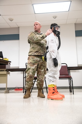 Members of the West Virginia National Guard provide hands-on personal protective equipment instruction to first responders from Kentucky and West Virginia, March 16, 2020, in Huntington, W.Va.
