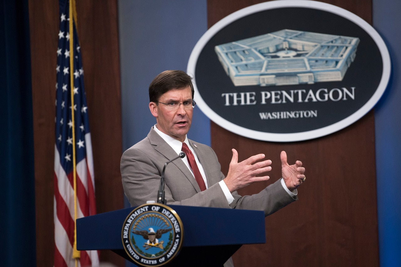 Defense Secretary Dr. Mark T. Esper speaks at a lectern.