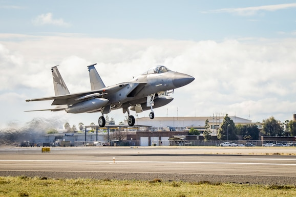 An F-15C Eagle from the 144th Fighter Wing takes off from the Fresno Yosemite International Airport during a beautiful Fresno morning, Mar. 17, 2020, to conduct a routine training mission, ensuring pilots maintain required training hours and the Wing maintains mission readiness. (U.S. Air National Guard photo by Capt. Jason Sanchez)