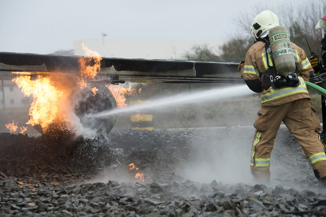 Photo of firefighter extinguishing flames.