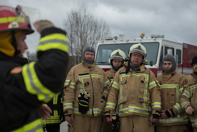 Photo of firefighters waiting for instruction.