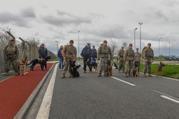 RAF Mildenhall Airmen stand in preparation for a 5K ruck march for K-9 Veterans Day at RAF Mildenhall, England, March 13, 2020. Mildenhall Airmen honored all the MWDs that served and died for the American military throughout history. (U.S. Air Force photo by Staff Sgt. Luke Milano)