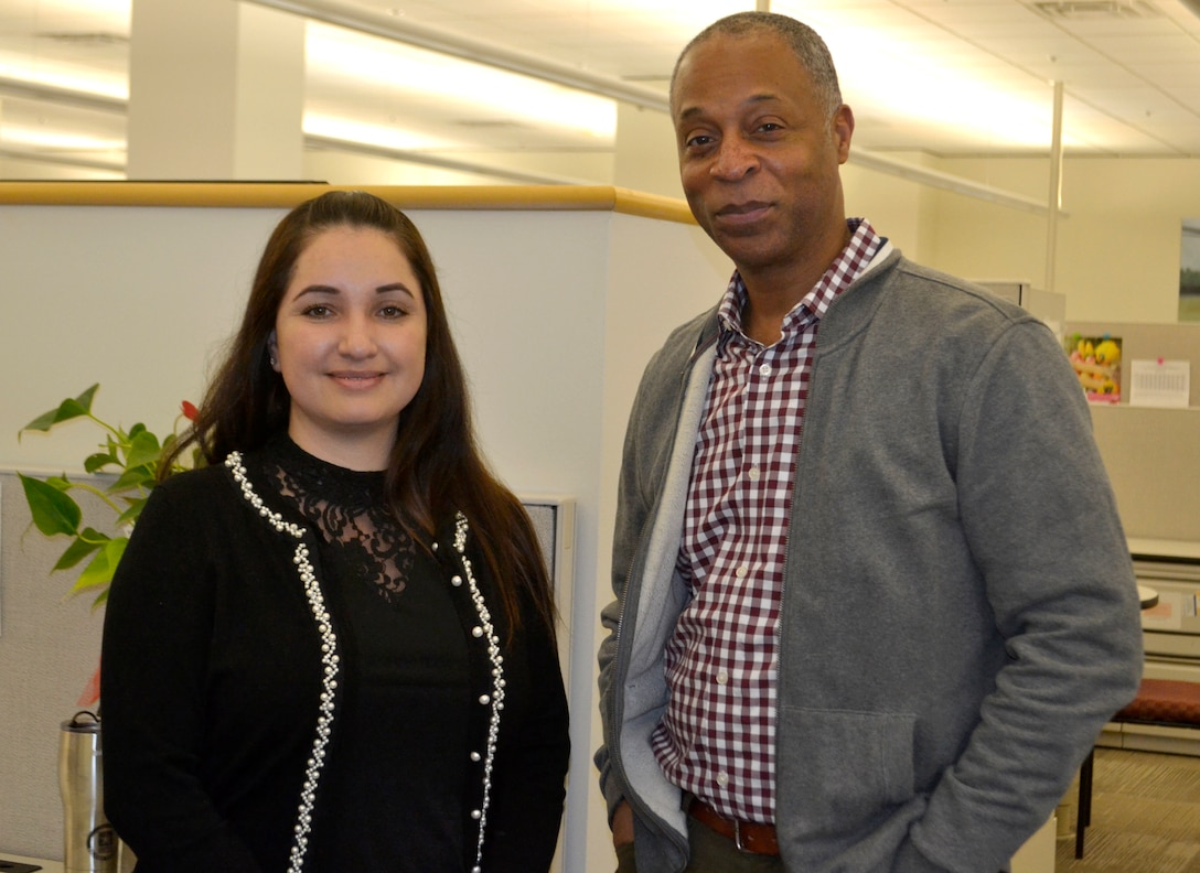 Gabriela Moraga, a Medical tailored vendor logistics specialist, left, and Peter Skillings, Medical's Collective and Foreign Military Sales branch chief, right, pose for a photo at DLA Troop Support March 13, 2020 in Philadelphia.
