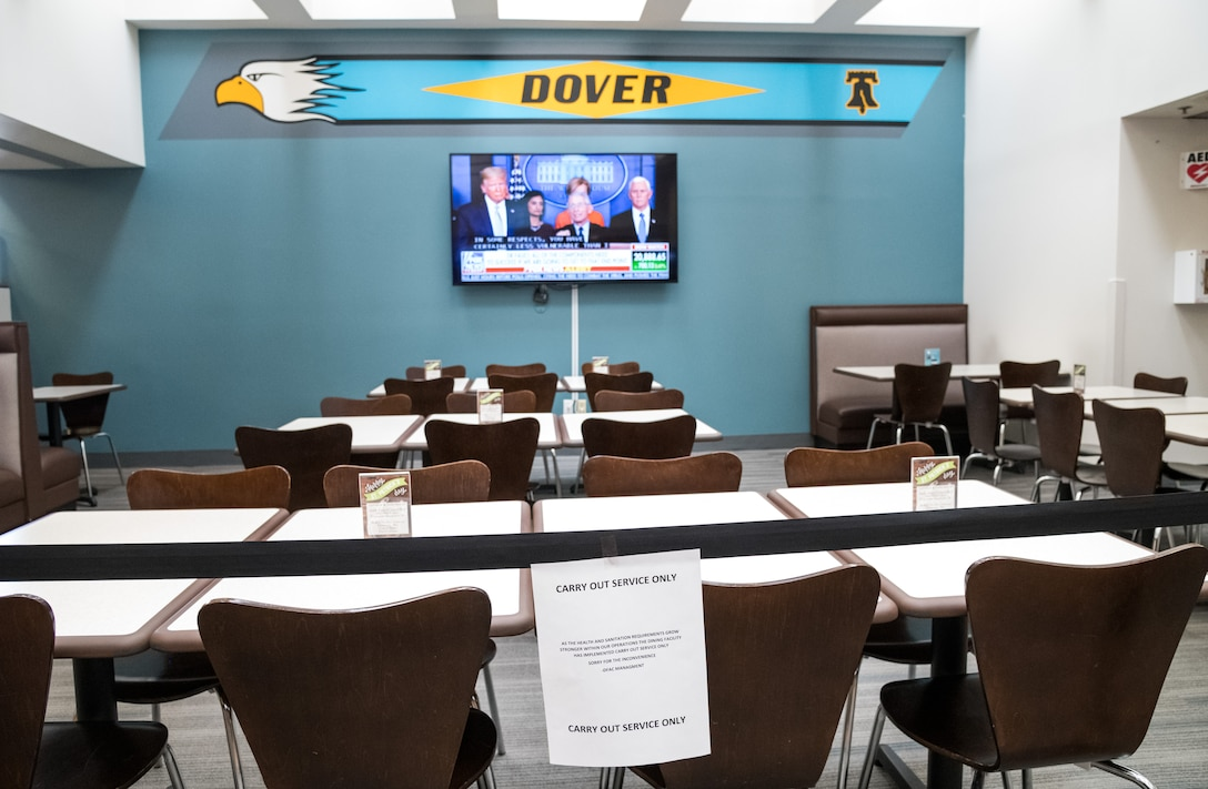 Chair and tables sit empty at the Patterson Dining Facility March 17, 2020, on Dover Air Force Base, Delaware. Meals are only available in to-go containers to mitigate the possible transmission of COVID-19. (U.S. Air Force photo by Roland Balik)