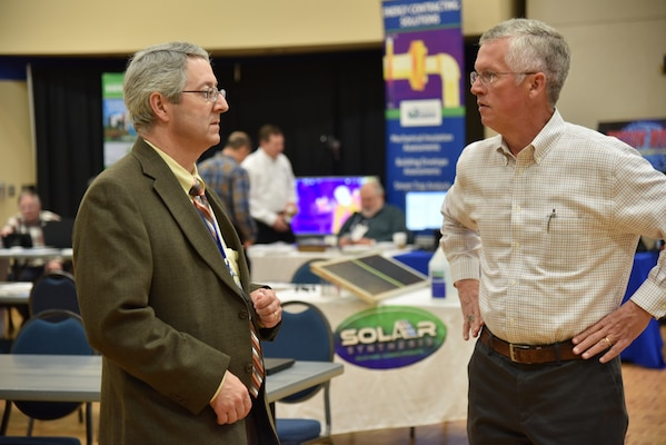 John Trudell, Huntsville Center Resource Efficiency Manager program manager, and Dan Howett, Federal Account Representative, Carrier Corporation, discusses the Chillers 101 presentation Howett made during the Army REM Workshop 2020 at the University of Alabama-Huntsville campus March 10-12.