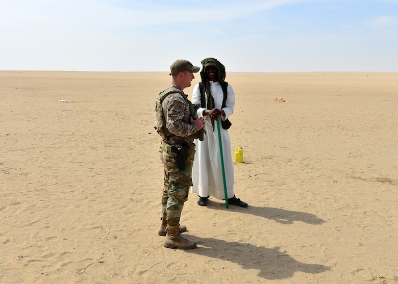 Airman interacts with Kuwait local