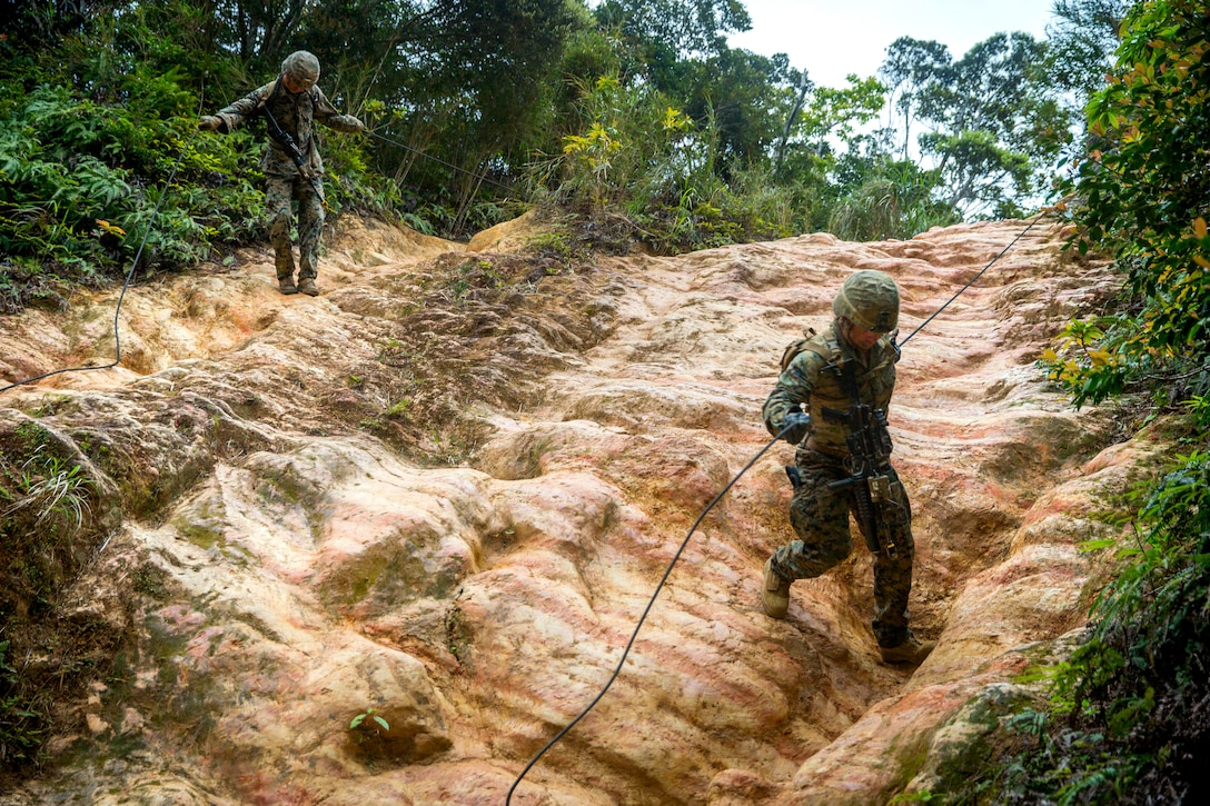 U.S. Marines assigned to 3rd Marine Division perform a hasty rappel during a squad competition at the Jungle Warfare Training Center in Okinawa, Japan, March 18. The competition was held to evaluate standards-based infantry training.