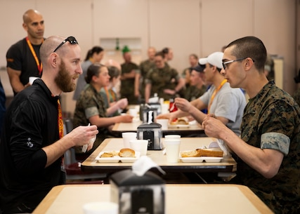 Nicholas Snyder, left, a teacher from Gov. Thomas Johnson High School, with Recruiting Station Frederick, eats lunch with a recruit during the Educator Workshop on Marine Corps Recruit Depot (MCRD) Parris Island, S.C., March 11, 2020. Participants with Recruiting Stations Frederick and Lansing visited MCRD Parris Island for a four-day period to observe recruit training and gain a better understanding of how recruits are transformed into Marines. (U.S. Marine Corps photo by Cpl. Cody J. Ohira)