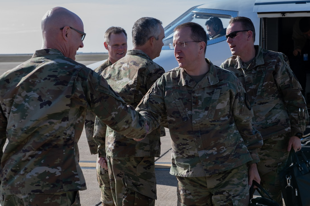 Chief Master Sgt. Brian A. Brindle, 137th Special Operations Wing command chief master sergeant, welcomes U.S. Air Force Lt. Gen. Jim Slife, commander of Air Force Special Operations Command (AFSOC), Hurlburt Field, Fla., to Will Rogers Air National Guard Base (WRANGB) in Oklahoma City, March 7, 2020. Slife and Command Chief Master Sgt. Cory M. Olson, AFSOC command chief master sergeant, visited WRANGB for an immersion visit that included a base tour and seeing firsthand the contributions that the 137th SOW makes to the special operations community. (U.S. Air National Guard photo by Senior Master Sgt. Andrew M. LaMoreaux)