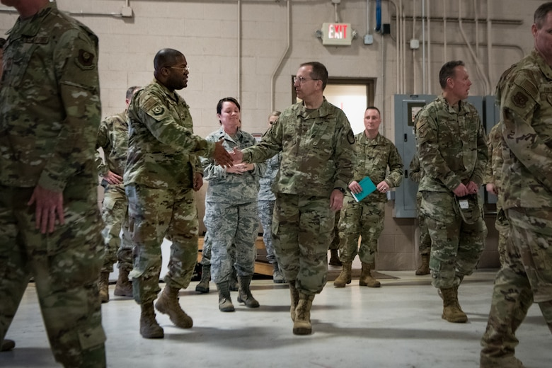 U.S. Air Force Lt. Gen. Jim Slife (right), commander of Air Force Special Operations Command, reaches to shake hands with Chief Master Sergeant Alquintin Steele (left), traffic management adviser for the 137th Special Operations Logistics Readiness Squadron (137th SOLRS), during an immersion tour of the 137th Special Operations Wing on March 7, 2020, at Will Rogers Air National Guard Base, Oklahoma City. The 137th SOLRS completed 111 tractor-trailer convoys to Minneapolis, New Mexio, Kansas, Louisiana, and Texas for a total of 87,000 miles in support of operational training and named exercises around the U.S. to support the squadrons on base in fulfilling their missions. (U.S. Air National Guard photo by Staff Sgt. Brigette Waltermire)