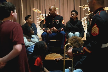 U.S. Marines from the 2nd Marine Division Brass Band play a concert with students from Greensboro, North Carolina March 2, 2020. After playing the concert, the Marine musicians mentored the music students, and discussed opportunities to pursue their musical careers in the Marine Corps. (U.S. Marine Corps photo by Sgt. Jacob Colvin)
