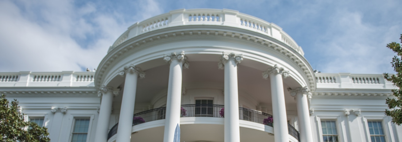 "Photo of the White House during an ""egg roll"" party, which is held on the South Lawn during an Easter celebration."