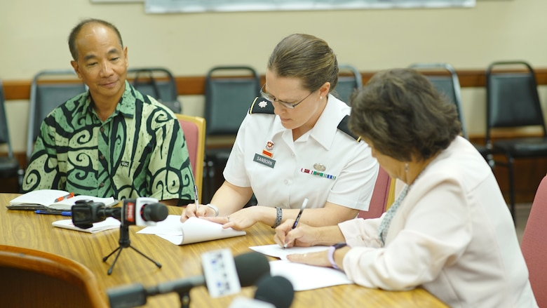 HAGATNA, GUAM ( March 10, 2020) -- Guam Gov. Lou Leon Guerrero and U.S. Army Corps of Engineers Honolulu District Commander Lt. Col. Kathryn Sanborn sign the $3 million Agana River (Hagatna River Flood Control) flood risk management study feasibility cost-share agreement.