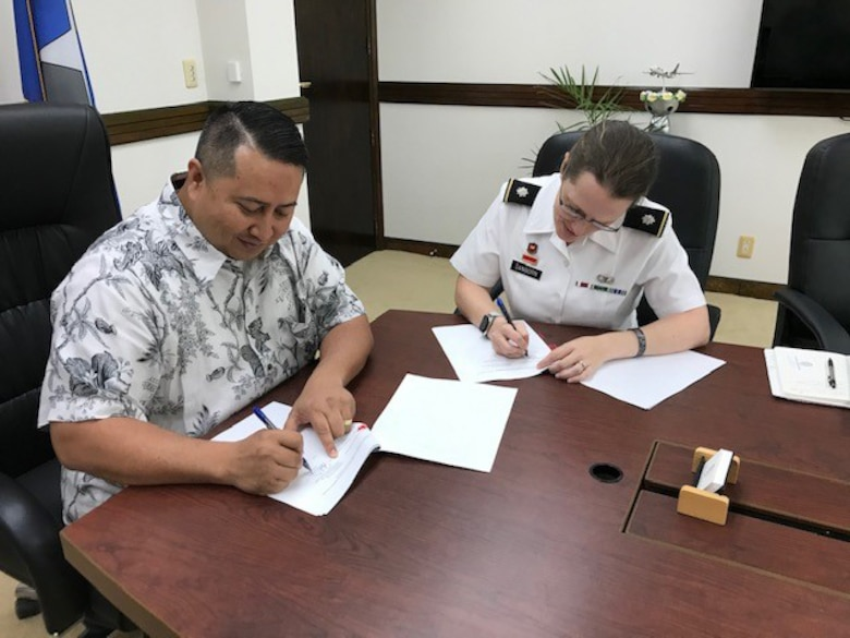 CAPITAL HILL, SAIPAN (MARCH 9, 2020) -- U.S. Army Corps of Engineers Honolulu District Commander Lt. Col. Kathryn Sanborn and Saipan Gov. Ralph Torres sign the Feasibility Cost-Share Agreement (FCSA) for the Saipan Beach Road Coastal Storm Damage Reduction Study.