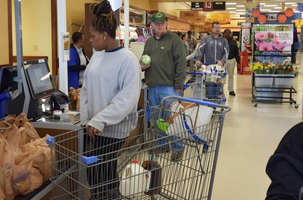 Shoppers at the Fort Lee, Virginia, Commissary, use the self-checkout lanes at the store. (Defense Commissary Agency photo by Mike Cerny)