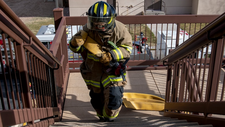 Firefighter walks up stairs.