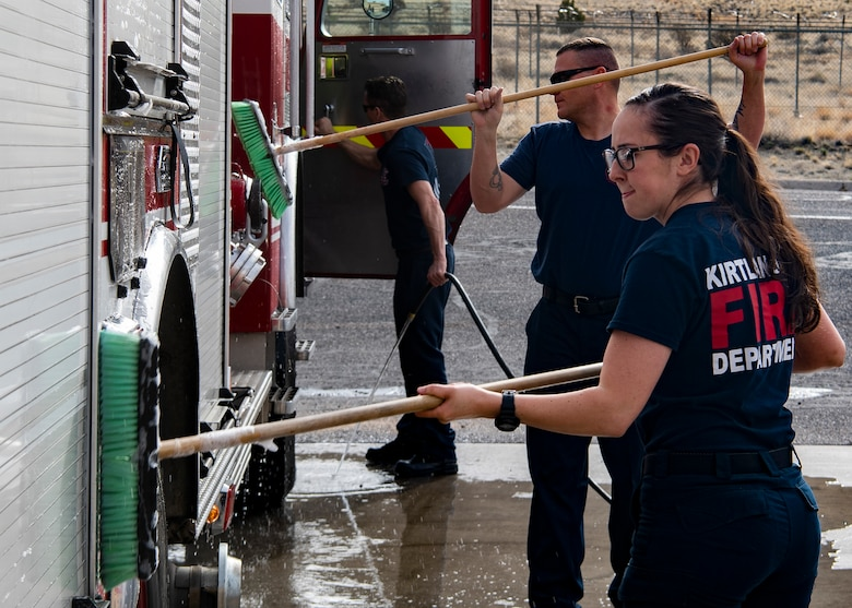 Firefighters wash the firetruck