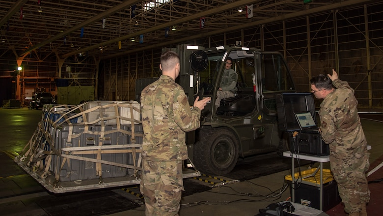 U.S. Air Force Staff Sgt. Daniel Cruz, a 35th Logistics Readiness Squadron outbound cargo supervisor, drives a forklift over the Weigh-In-Motion scales at Misawa Air Base, Japan, March 13, 2020. The WIM scale saves countless man-hours by collecting necessary data all at once through an advanced system of sensors, dynamic measurement system and data archiving. (U.S. Air Force photo by Airman 1st Class China M. Shock)