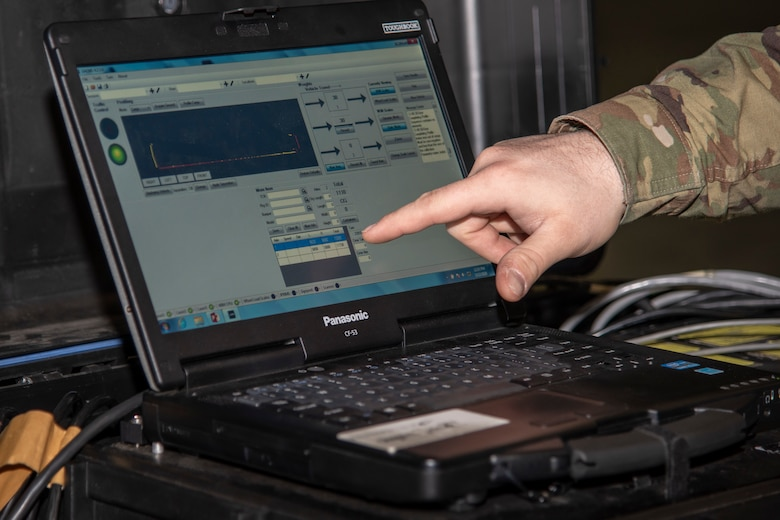 U.S. Air Force Staff Sgt. James Davis, a 35th Logistics Readiness Squadron cargo movement supervisor, monitors and records the weight of cargo at Misawa Air Base, Japan, March 13, 2020. The laser profile system cuts cargo check-in time by a projected 75 percent, reduce manpower from three personnel to one and save roughly four man-hours per C-17 cargo load. (U.S. Air Force photo by Airman 1st Class China M. Shock)