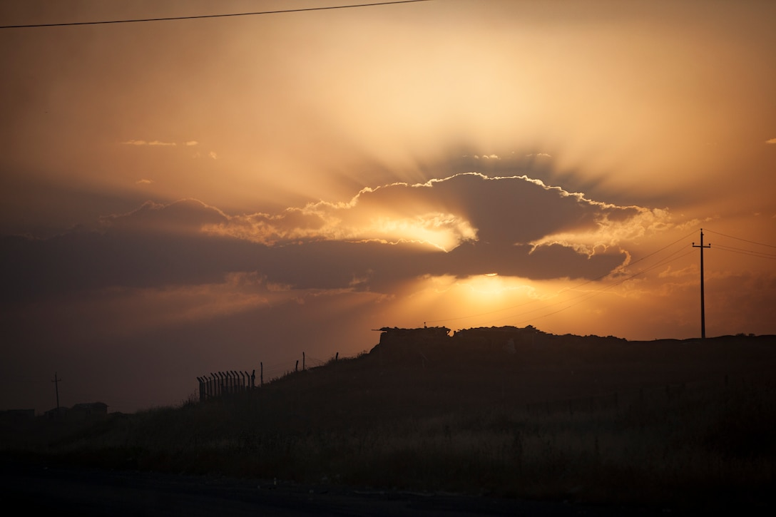 The sun sets over a security and observation outpost controlled by Peshmerga soldiers and Zeravani Police, both parts of the Kurdistan Regional Government's security forces supporting the Iraqi security forces, near the Combined Joint Task Force – Operation Inherent Resolve forward line of troops in Erbil Province, Iraq, May 29, 2016. The Peshmerga and Zeravani Police have been coordinating with the Iraqi security forces and Coalition partners to assist in the regional removal of Da'esh. CJTF – OIR aims to enable and equip indigenous forces to confront ISIL head on while leveraging U.S. and Coalition nation airpower to halt the terrorist's momentum. (U.S. Army photo by Staff Sgt. Sergio Rangel/RELEASED)