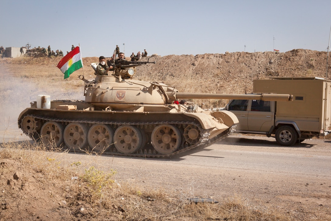 Peshmerga soldiers, part of the Kurdistan Regional Government's security forces supporting the Iraqi security forces, operate a tank at a security outpost toward the Combined Joint Task Force – Operation Inherent Resolve forward line of troops in Erbil Province, Iraq, May 29, 2016. The Peshmerga have coordinated with the Iraqi security forces and Coalition partners to assist in the regional removal of Da'esh. CJTF – OIR aims to enable and equip indigenous forces to take ISIL head on while leveraging U.S. and Coalition nation airpower to halt the terrorist's momentum. (U.S. Army photo by Staff Sgt. Sergio Rangel/RELEASED)