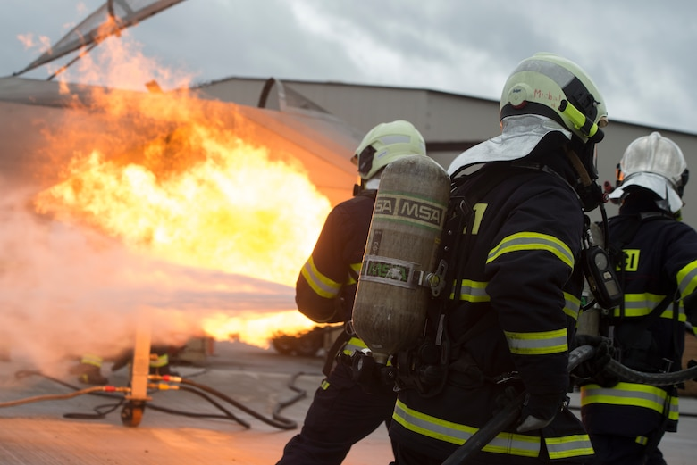 Photo of firefighters extinguishing flames.