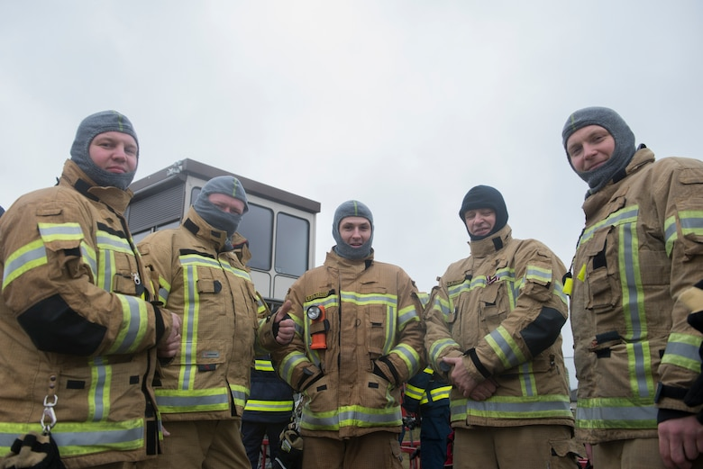 Photo of firefighters posing for a photo.