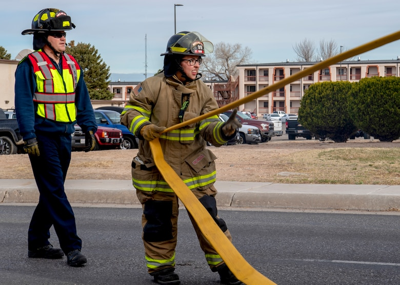 Firefighters conduct training exercise.