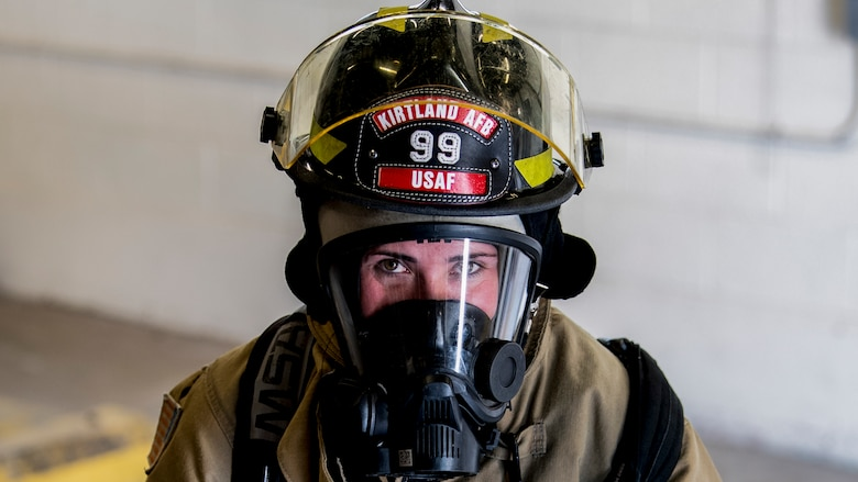 Firefighter gears up.