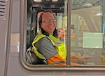 Forklift driver poses for a photo