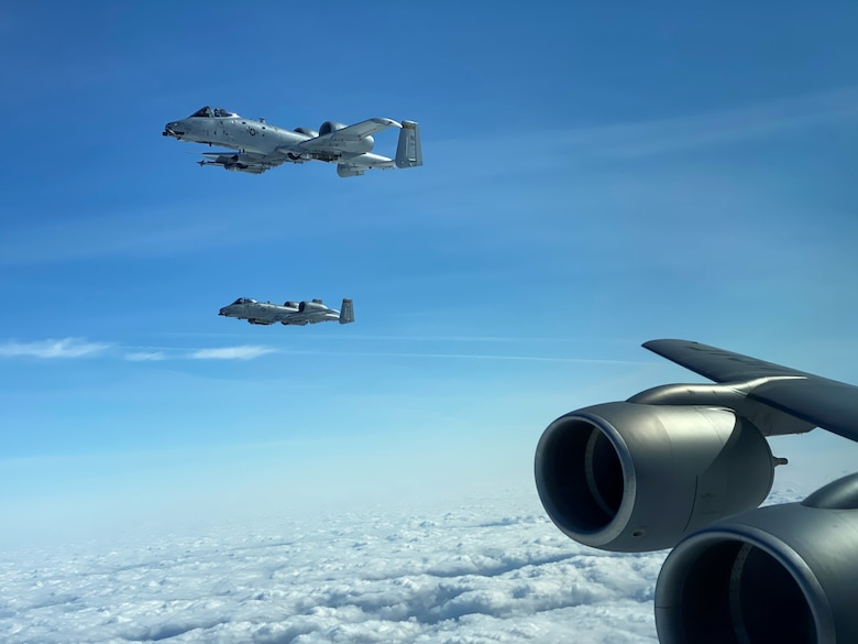 Social distancing wasn't a problem for A10 Warthogs from the 122nd Fighter Wing, Fort Wayne, Indiana., and a KC-135R Stratotanker from Grissom Air Reserve Base, Indiana., March 17, 2020 as the units paired up for a refueling mission in the skies over Northcentral Indiana. Despite the Novel Coronavirus pandemic both units continue to work to meet Air Force mission requirements. (U.S. Air Force photo Capt. Steven Bretscher)