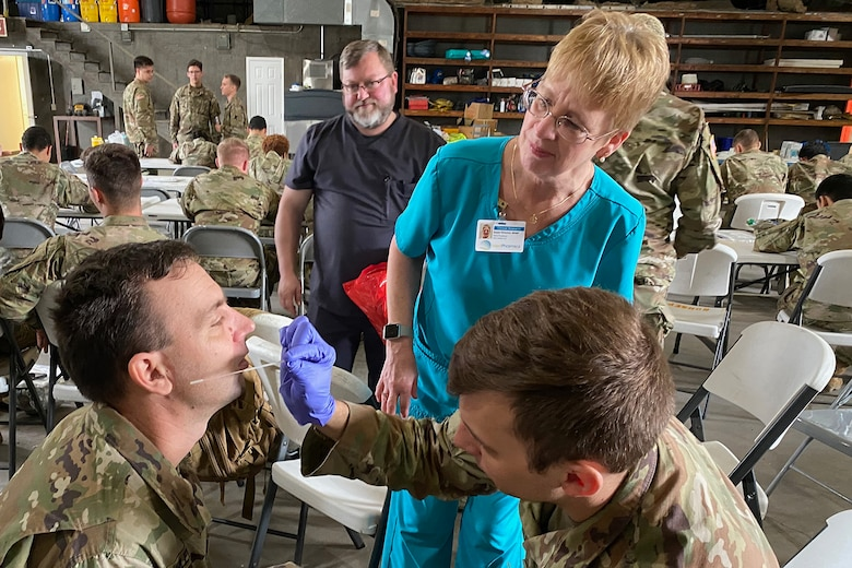 Louisiana National Guard medics, from both the Air and Army, conduct training with the Department of Health and Human Services to ensure proper protection and administration of test kits occurs during drive-thru testing, March 18, 2020, in New Orleans. (Photo by Maj. John Meche)