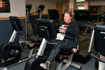 Melissa Smith pedals away on the recumbent bike during the Pi Day observance March 11.
