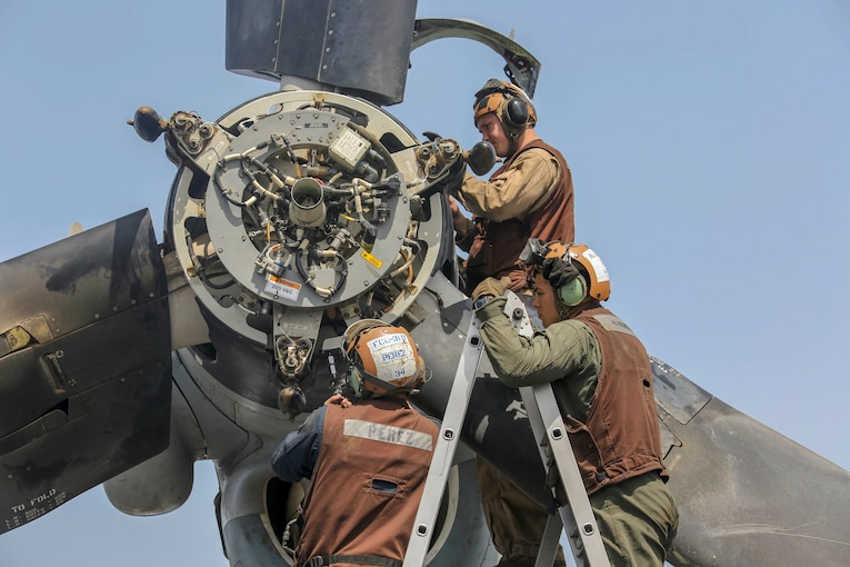Marines work on an aircraft.