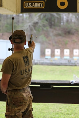 Sgt. 1st Class Rosendorn fires during the Precision Pistol phase at All Army, one of the many competitive formats used at the event, which also included combat rifle, combat pistol, and action shooting courses.