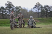 "Team Coach Sgt. 1st Class Rosendorn instructs the 3-335th TSBn Soldiers prior to a stage of fire. ""Team Blackhawks"" took first place among the other Army Reserve teams."
