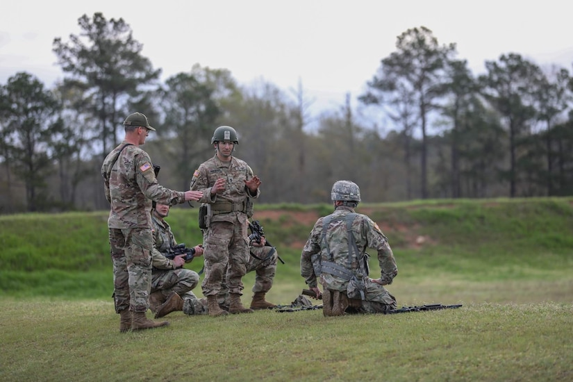 """Team Coach Sgt. 1st Class Rosendorn instructs the 3-335th TSBn Soldiers prior to a stage of fire. """"Team Blackhawks"""" took first place among the other Army Reserve teams."""