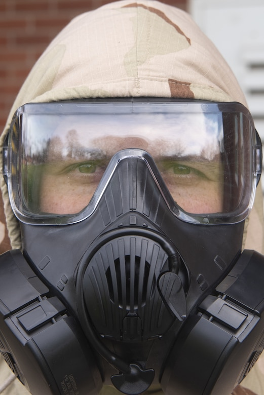 Airman 1st Class Kamron Karnes, 100th Maintenance Squadron Aerospace Ground Equipment apprentice, poses for a photo in his M50 gas mask March 17, 2020, at RAF Mildenhall, England. Emergency management Airmen are responsible for ensuring Airmen like Karnes have the skills needed to operate their chemical, biological, radiological and nuclear protective gear. (U.S. Air Force photo by Airman 1st Class Joseph Barron)
