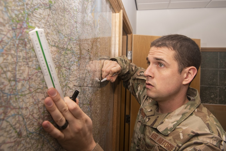 Staff Sgt. Patrick O'Donnell, 100th Civil Engineer Squadron Emergency Management journeyman, plots the affected area resulting from a simulated contamination event March 18, 2020, at RAF Mildenhall, England. Emergency management Airmen create and maintain base plans that establish the response to crises like hazardous material spills, aircraft crashes and natural disasters. (U.S. Air Force photo by Airman 1st Class Joseph Barron)