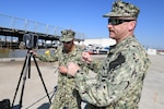 Port Hueneme, CA - Left to right: Navy reservists Yeoman First Class Bryan Rojas and Chief Information Systems Technician Ivan Price, both with Naval Information Warfare Systems Command's Configuration Validation team, LIDAR scanning the Self Defense Test Ship at Naval Surface Warfare Center, Port Hueneme Division.