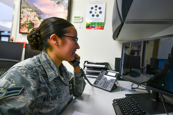 U.S. Air Force Airman 1st Class Lilly Walkup, 31st Medical Group Public Health technician, answers a phone call March 17, 2020, at Aviano Air Base, Italy. The Public Health office has dedicated 2,850 man hours and counting to combat COVID-19, with close to 3,000 screenings conducted throughout the wing. (U.S. Air Force illustration by Senior Airman Kevin Sommer Giron)