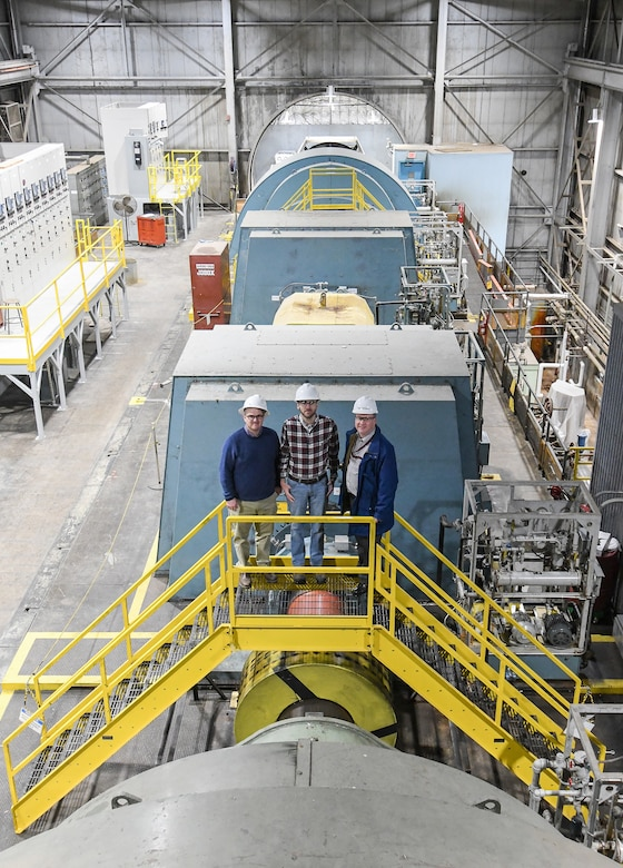 Shelby Moorman, left, an electrical systems engineer, Ethan Jobe, a plant operations engineer, and Tyler McCamey, a program manager, pose for a photo in the Main Drive building of the Arnold Engineering Development Complex (AEDC) Propulsion Wind Tunnel (PWT) Facility Feb. 7, 2020, at Arnold Air Force Base, Tenn. AEDC team members determined a new configuration of the motors to power the compressors, resulting in a significant power savings. (U.S. Air Force photo by Jill Pickett)
