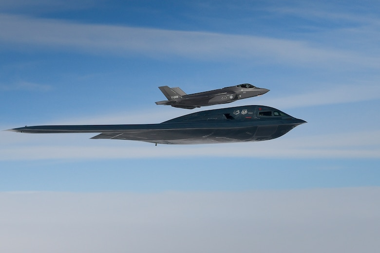 A U.S. Air Force B-2A Spirit assigned to the 509th Bomb Wing and Royal Netherlands Air Force F-35A Lightning II conduct aerial operations in support of Bomber Task Force Europe 20-2 over the North Sea, March 18, 2020. Bomber missions provide opportunities to train and work with NATO allies and theater partners in combined and joint operations and exercises. (U.S. Air Force photo by Master Sgt. Matthew Plew)