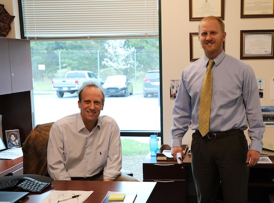 Joey Behr, a Program Manager in the Business Integration Division (right) visits with his boss, Scott Cilley at the Transatlantic Division's headquarters in Winchester, Va. Behr was named the Transatlantic Division's Employee of the Quarter for October-December 2019 during All-Hands Town Hall held across the globe on March 19, 2020. Employees from inside the U.S. and from a dozen countries in the Middle East attended the Town Hall telephonically in response to the COVID-19 pandemic.