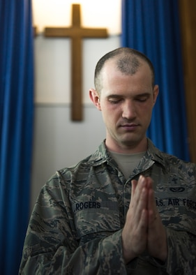 1st Lt. Jacob Rogers, 366th Fighter Wing chaplain, bows his head in prayer, March 18, 2020, at Liberty Chapel on Mountain Home Air Force Base, Idaho. The Chapel has started transitioning most of its programs and services to online platforms to continue to take care of Airmen and families during the Covid-19 pandemic. (U.S. Air Force photo by Airman 1st Class Andrew Kobialka)
