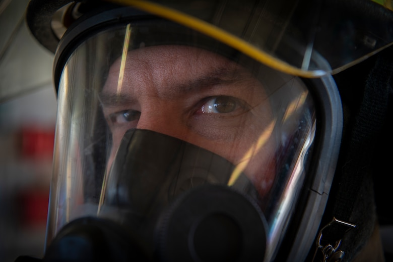 Jim Kuhn, 50th Civil Engineer Squadron firefighter, wears protective gear during an equipment inspection at Schriever Air Force Base, Colo., March 6, 2020. Firefighters wear respiratory equipment when responding in hazardous environments that could hinder their ability to breathe, such as an area with heavy smoke. (U.S. Air Force photo by Airman 1st Class Jonathan Whitely)