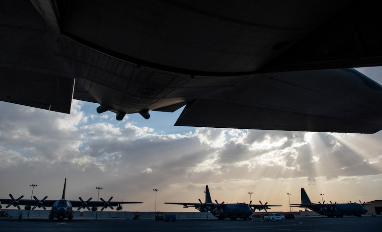 MC-130H Combat Talon IIs and AC-130W Stinger IIs park on the flightline of Ali Al Salem Air Base, Kuwait, March 14, 2020. The MC-130 and AC-130 are variants of the C-130 and have wide skill sets that can lend themselves to a variety of missions. (U.S. Air Force photo by Senior Airman Kevin Tanenbaum)