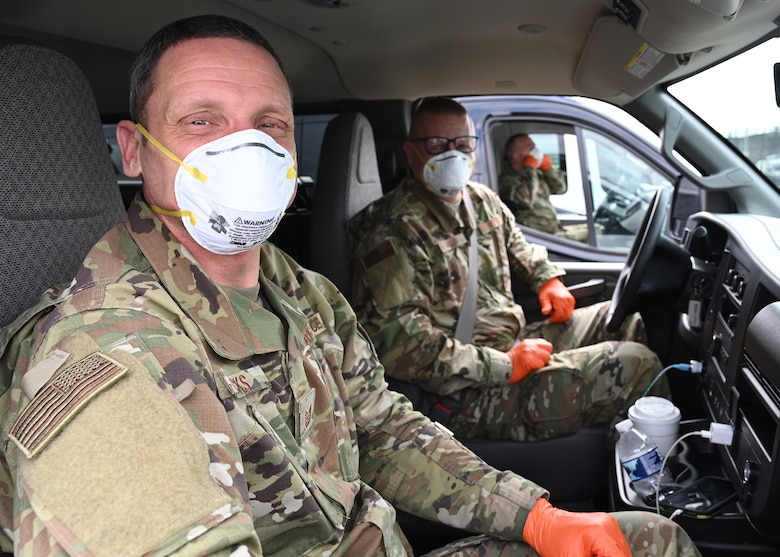 U.S. Air Force Tech. Sgt. Brian Hicks (Left) and U.S. Air Force Master Sgt. Richard Malloy, 175th Logistics Readiness Squadron, Maryland Air National Guard, wear medical personal protective equipment inside a van before transporting passengers from the Grand Princess cruise ship who have been quarantined due to the novel Coronavirus (COVID-19) pandemic, Baltimore, Md., March 17, 2020.