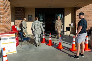 Photo of Moody Airmen setting up for a Stop, Check, Go health screening in front of the commissar.